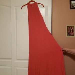 Coral colored maxi dress.